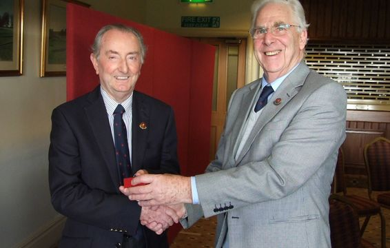 Tony Moss receives Honorary Vice Presidents badge from Peter Wilson Senior Vice President