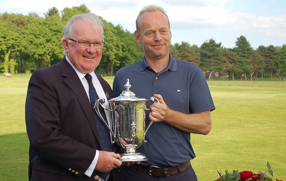 County Champion, Mark Ashworth, receives the trophy from President, Andrew Barr