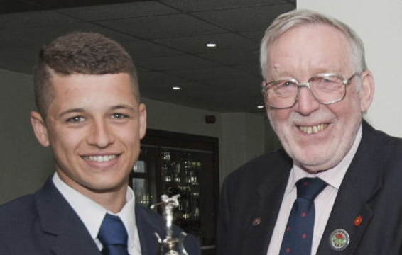 Boys Champion 2013 Haydn McCullen with President Alan Rawlinson